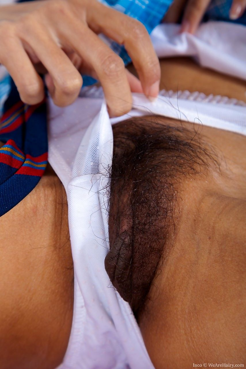 Young looking Asian schoolgirl Inco dildos her beaver after removing panties