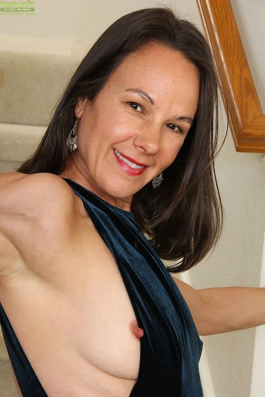 Mature housewife Sandra Myer shows off her thin body in the nude on stairs