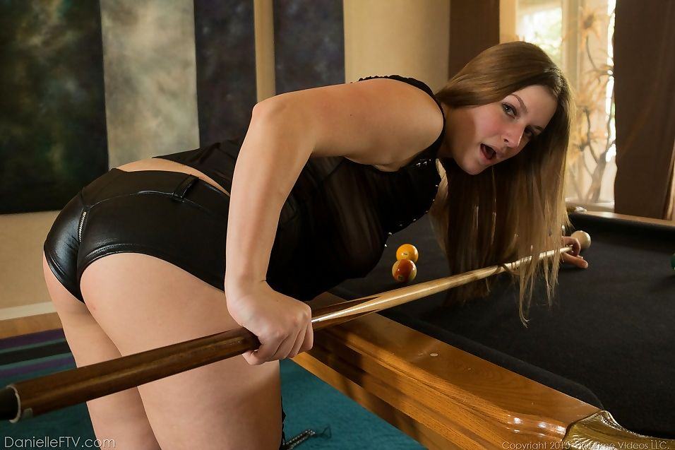 Hot Danielle in leather shorts & tall boots spreading pussy on the pool table