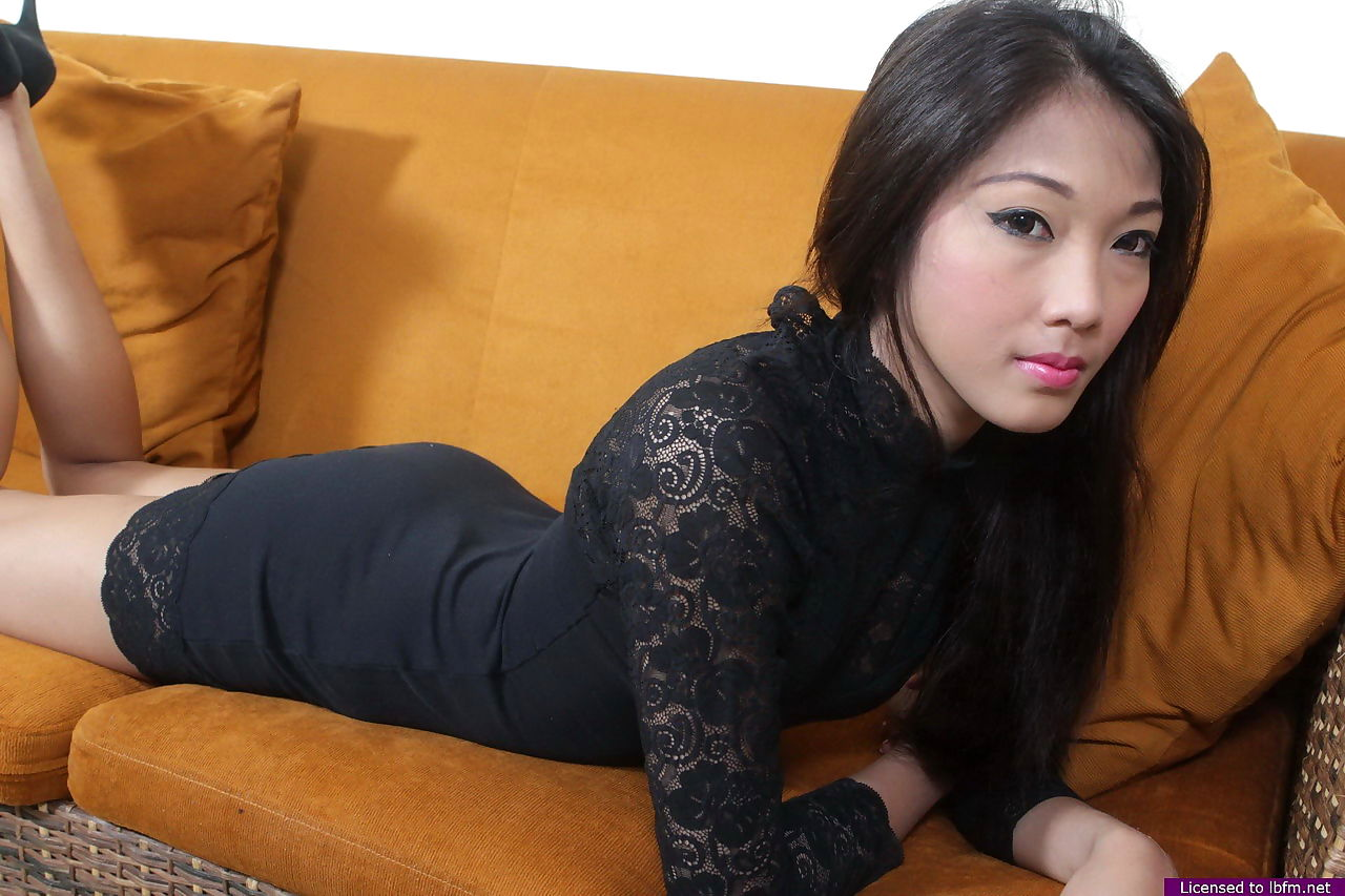 Stunning amateur Asian girl removes hot black panties & poses naked on sofa