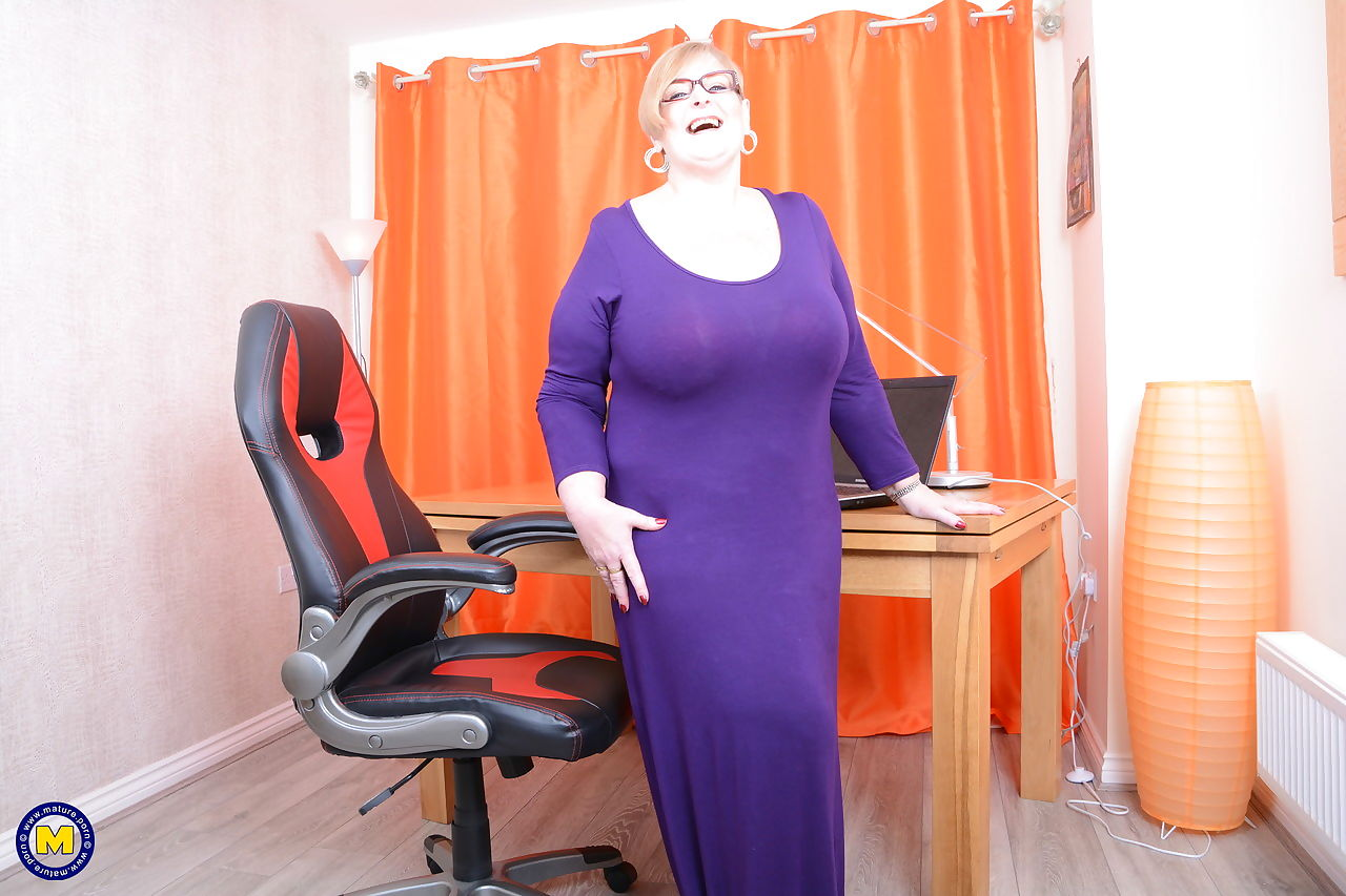 Huge fatty mature secretary removes long dress to lick saggy tits at her desk