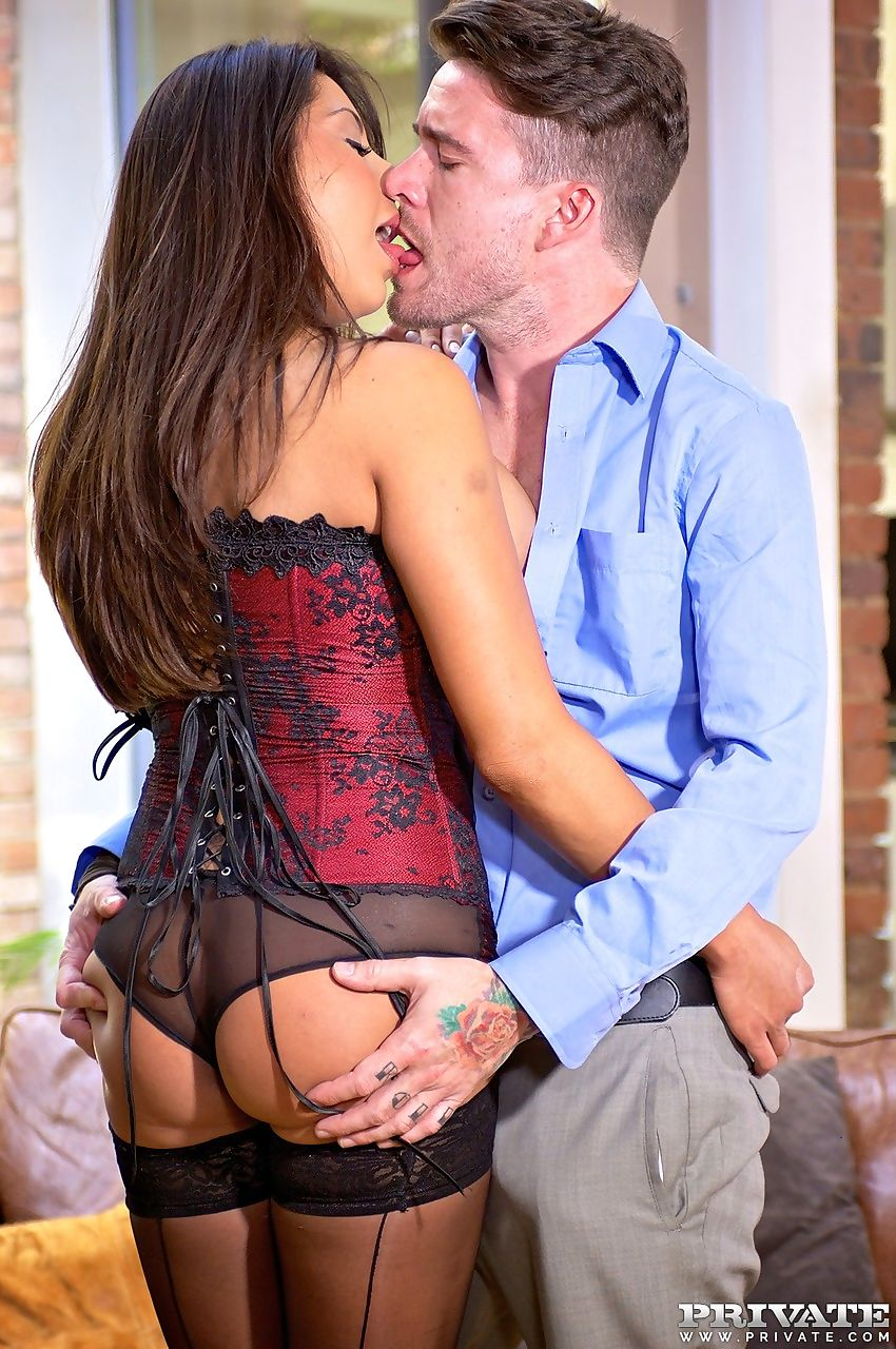Asian MILF Candi Coxx fucks her man wearing a sexy bustier and black stockings