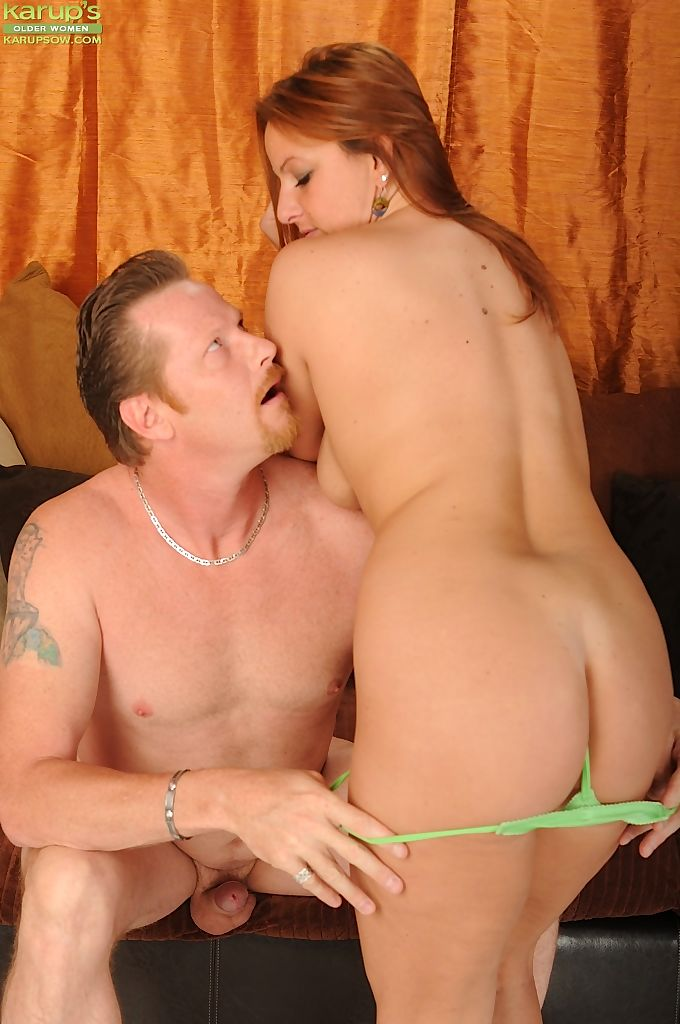 Redhead female Gia Sophia is stripped of her clothes before fuckinng