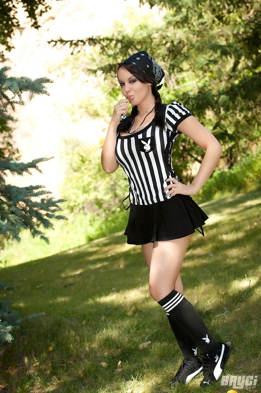 Amateur girl Bryci sets her beautiful boobs free of referee uniform on lawn