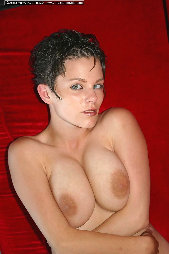 First timer with short hair strips naked on a red sofa for first nude poses