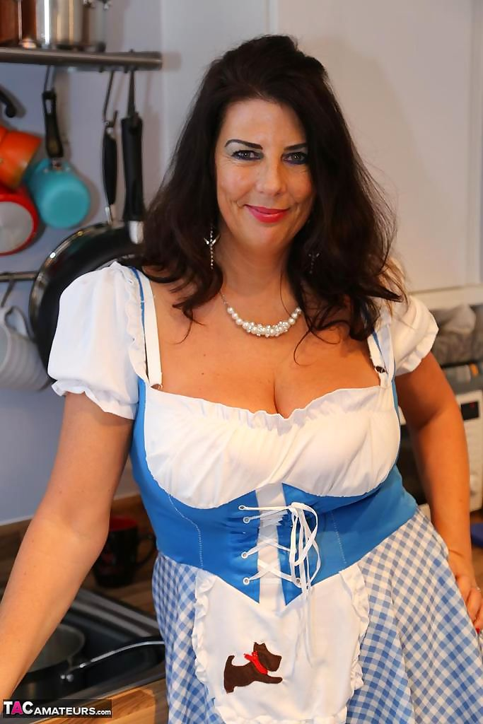 Brunette amateur Lu Lu Lush exposes her knockers while baking in the kitchen