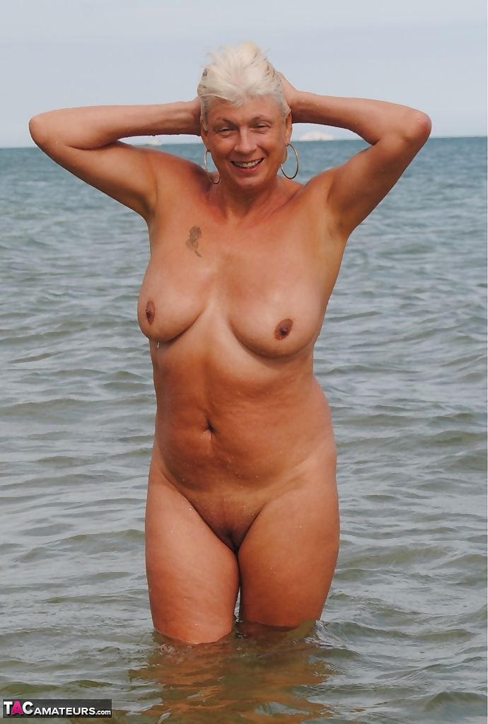 Mature British woman Denise Davies likes flashing her saggy tits in public