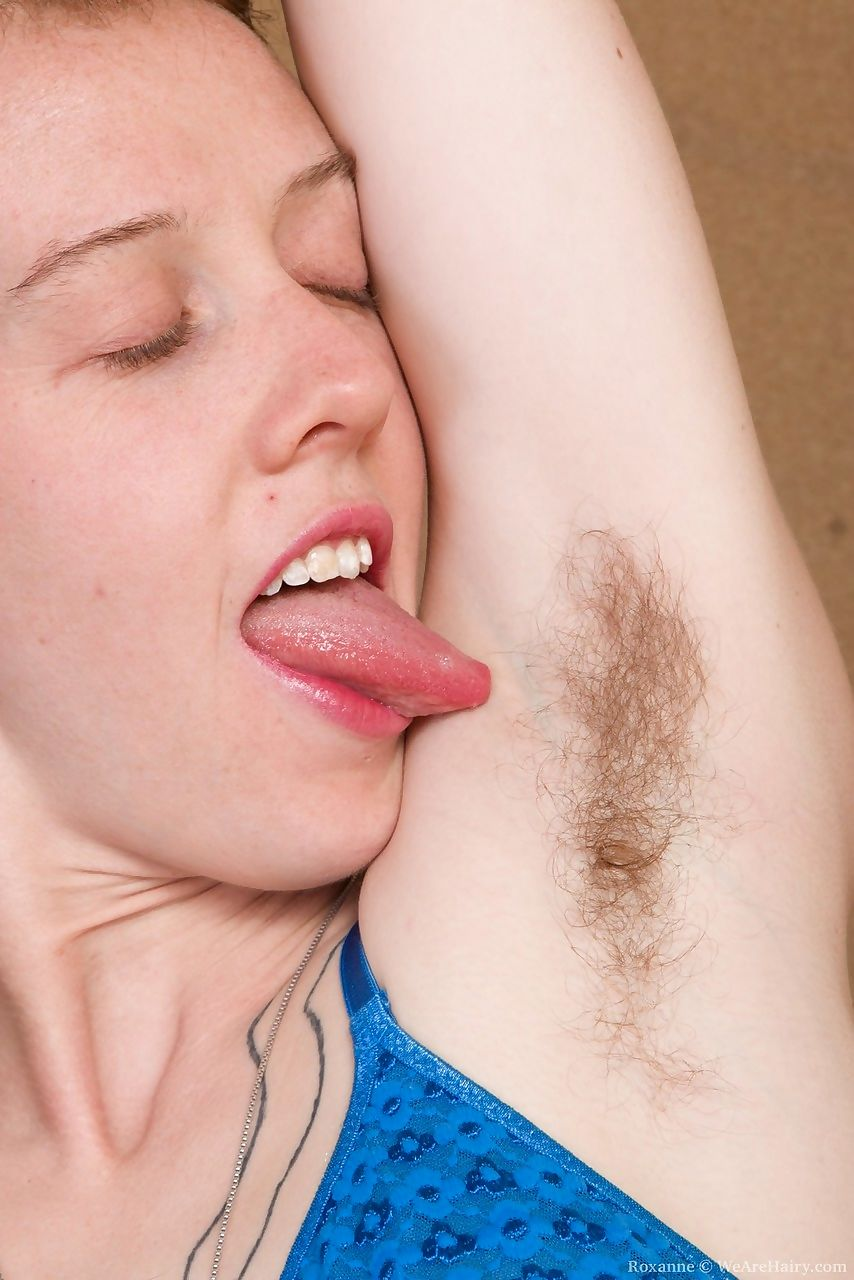 First timer Roxanne reveals hairy pits before spreading her ginger beaver