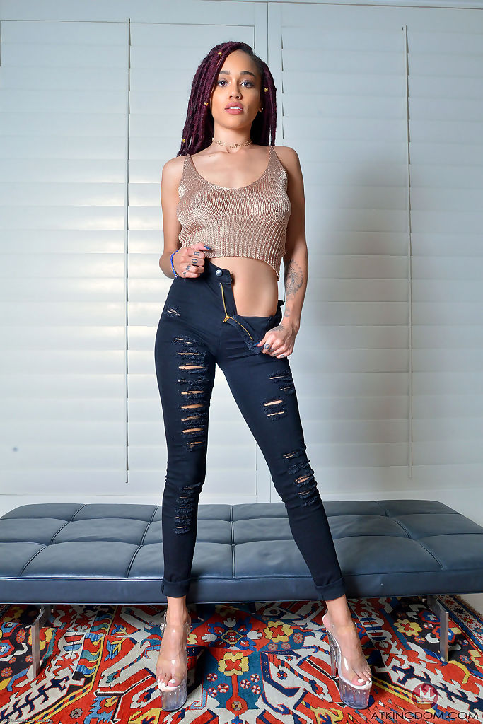 Ebony amateur Julie Kay removes ripped jeans to display her pink pussy