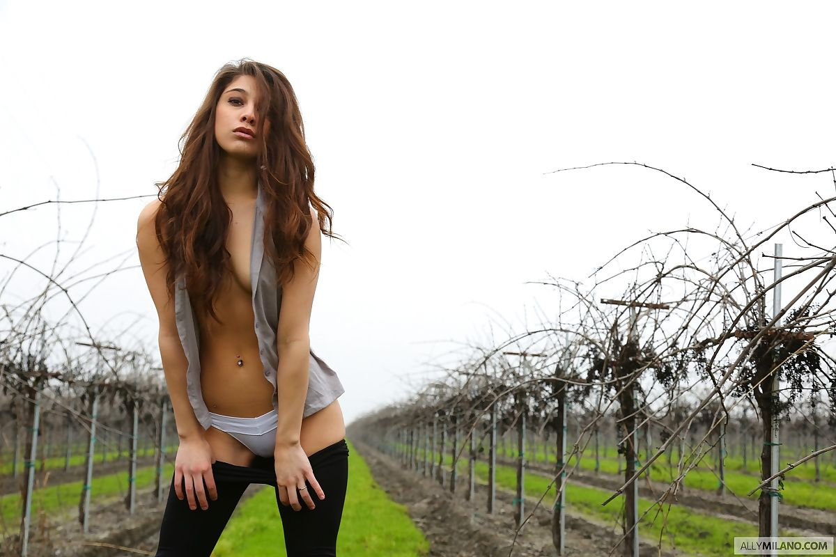 Amateur girl Ally Milano exposes thong covered ass between rows of grape vines