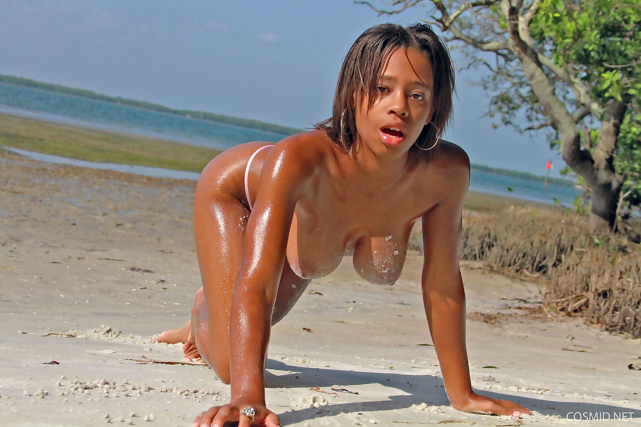 Black amateur Tierra Watson touts her great tits and hot ass at the beach