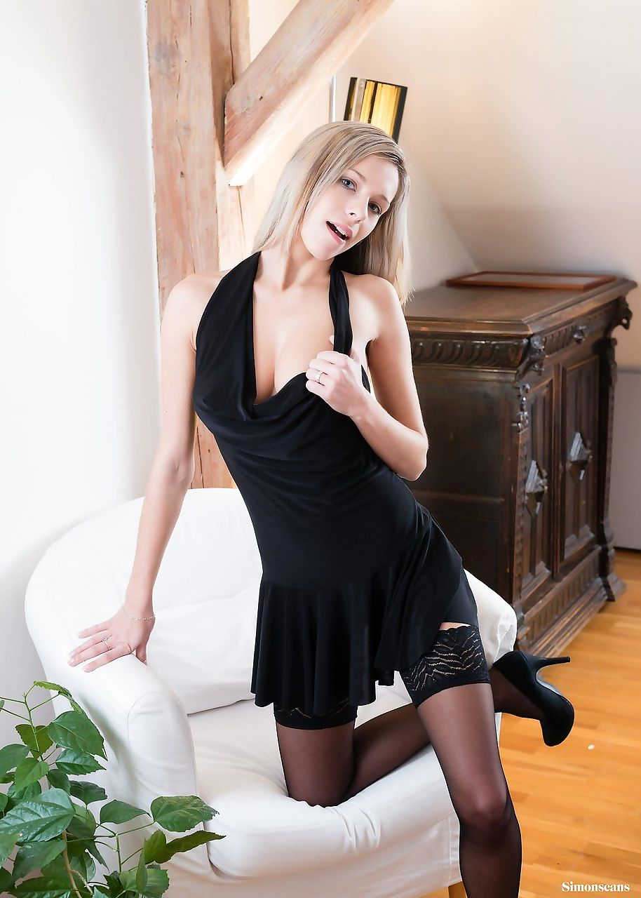 Dirty blonde amateur Tracy Smile removes black dress before toying her pussy