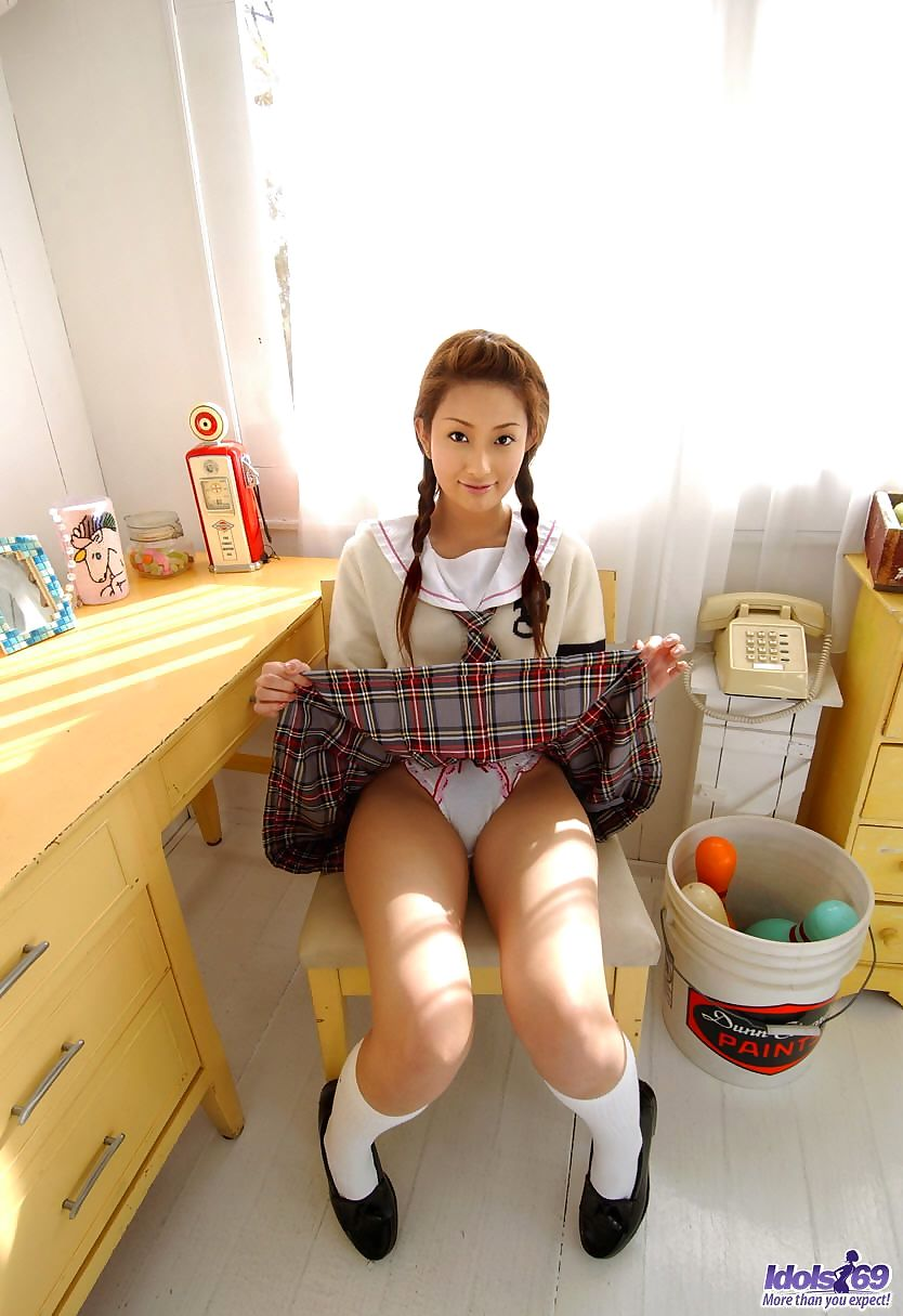 Cute Japanese schoolgirl Nao Yoshizaki removes cute panties to show her bush