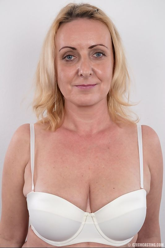 Middle-aged blonde lady Gerlinda stands totally nude after disrobing