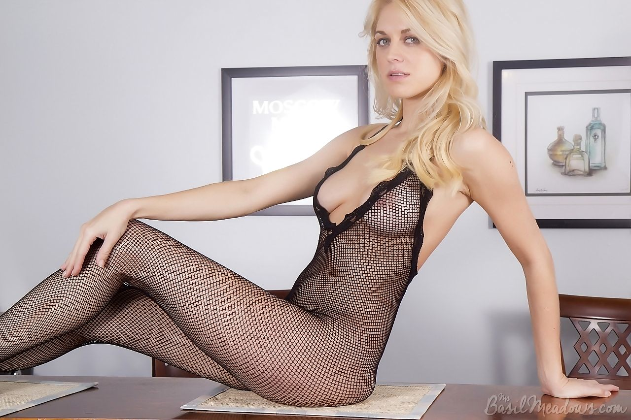 Blonde amateur Basil Meadows poses solo in a mesh bodystocking