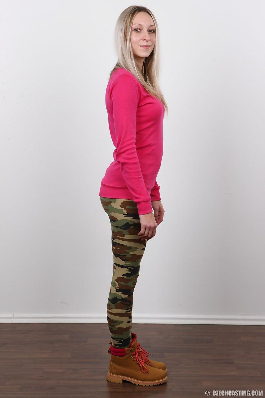 Solo girl in camo pants strips naked for the very first time