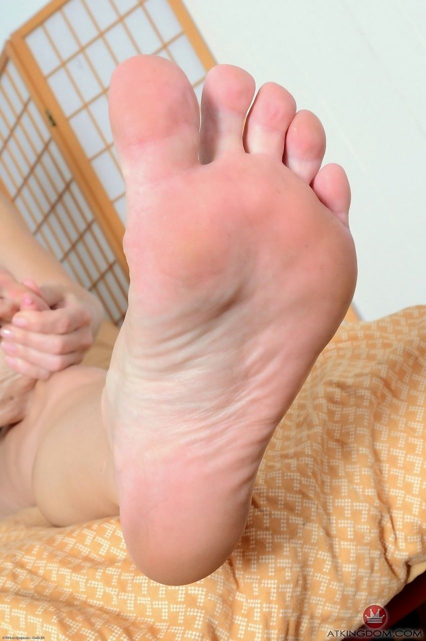 Older lady Helena Locke licks her big toes while removing sensual lingerie