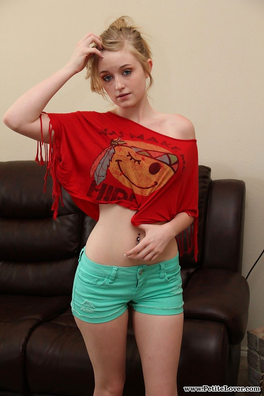 Young blonde girl shows off her thin body in the nude for the first time