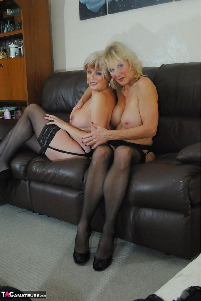 Older blonde women spank bare asses during lesbian play in stockings