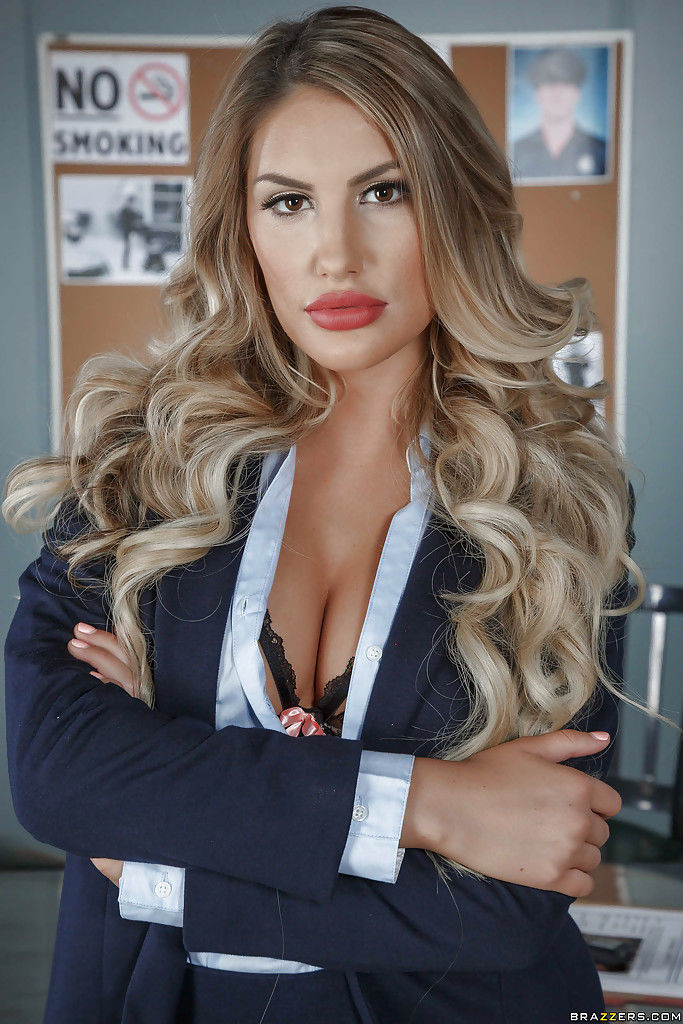 Stocking clad blonde babe August Ames revealing big pornstar tits in office