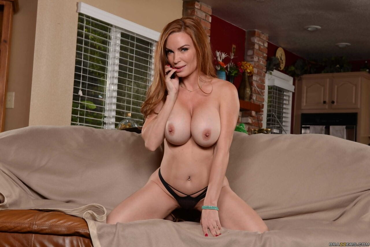 Redhead cougar Diamond Foxxx unveils her huge big tits to spread on the couch