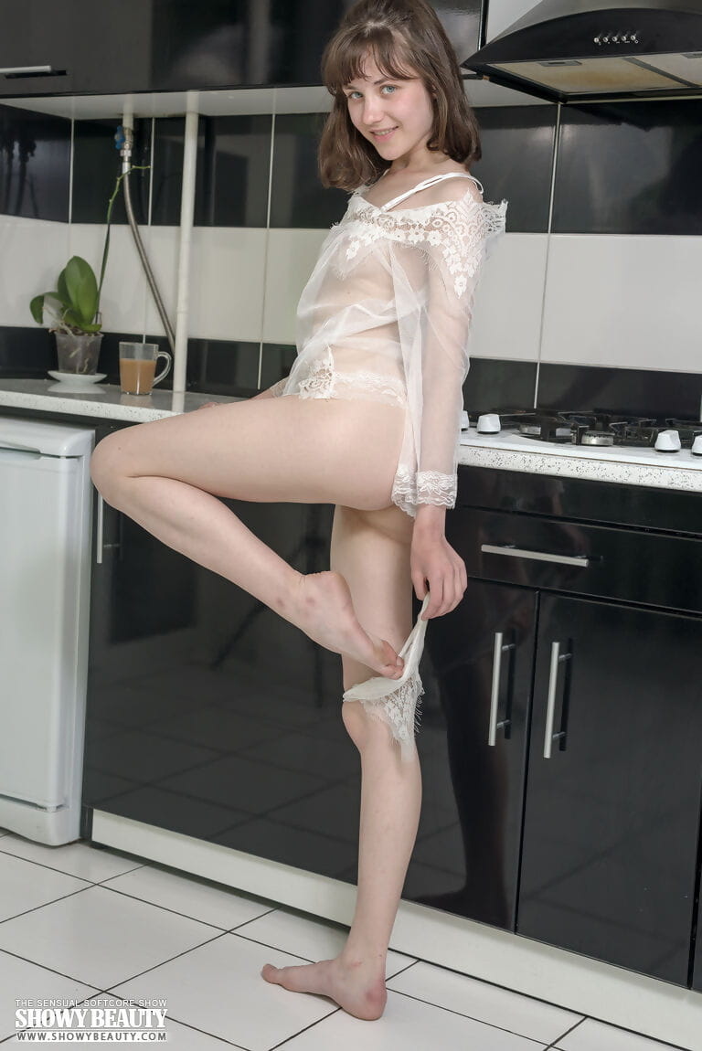 First timer removes see thru attire for totally nude poses in the kitchen