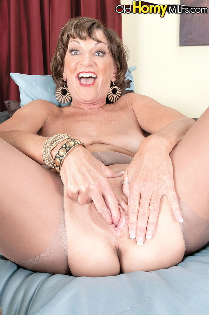 Mature woman Sydni Lane casts her animal print dress aside for a finger fuck