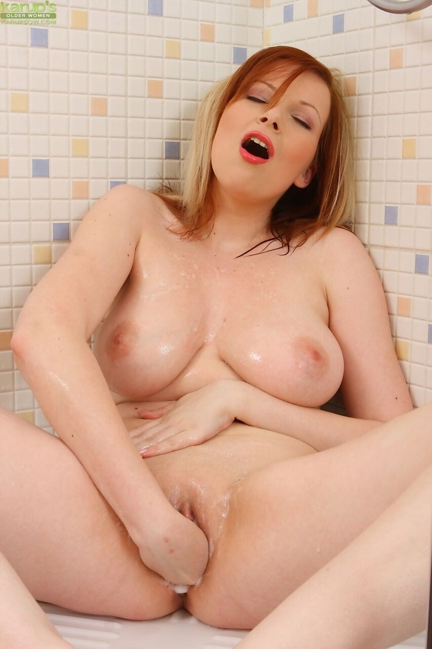 Sexy mature Ricky sheds hot lingerie to show big saggy tits & finger in shower