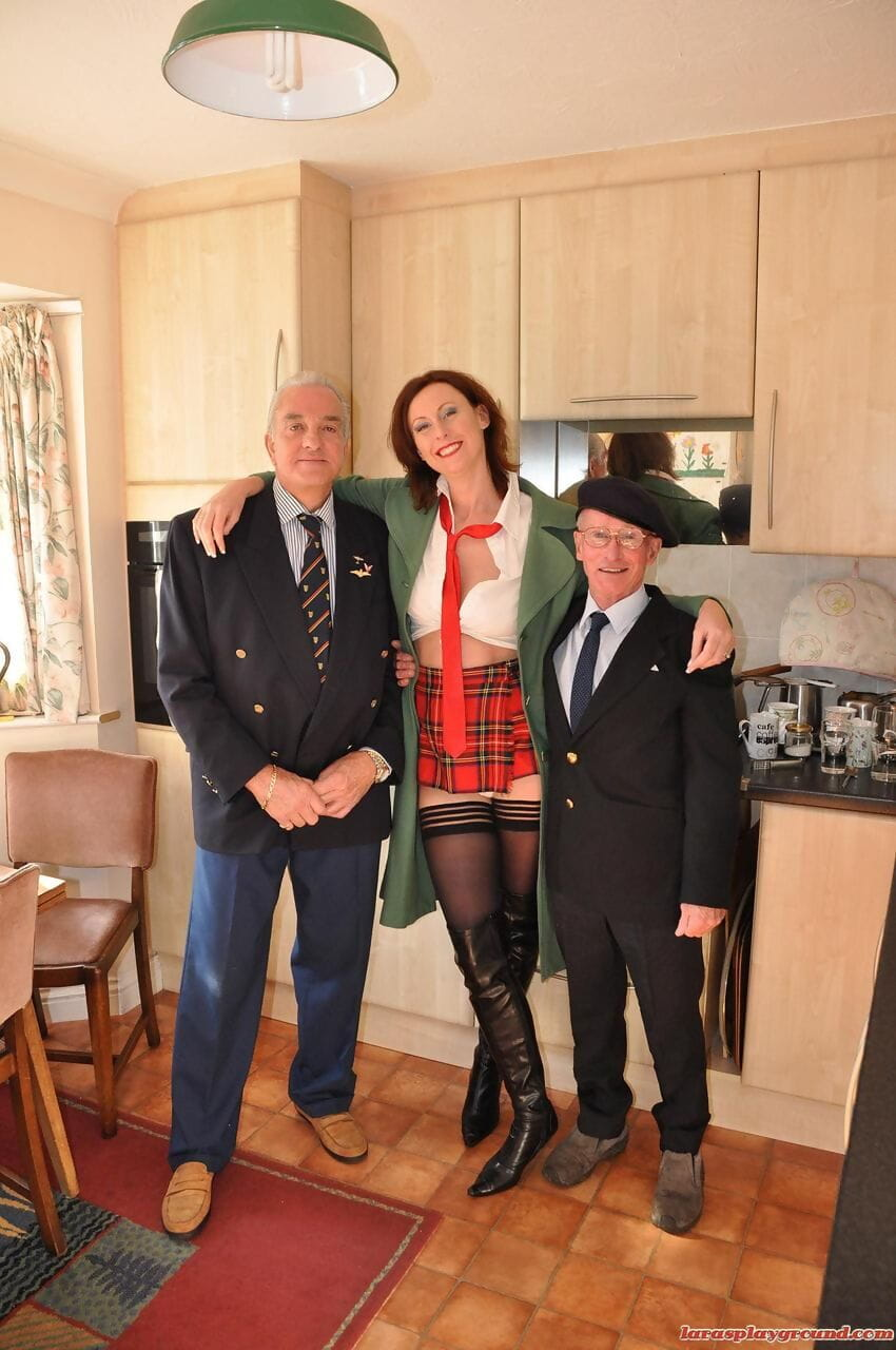 Mature redhead in schoolgirl uniform Lara Latex got sandwiched in a threesome