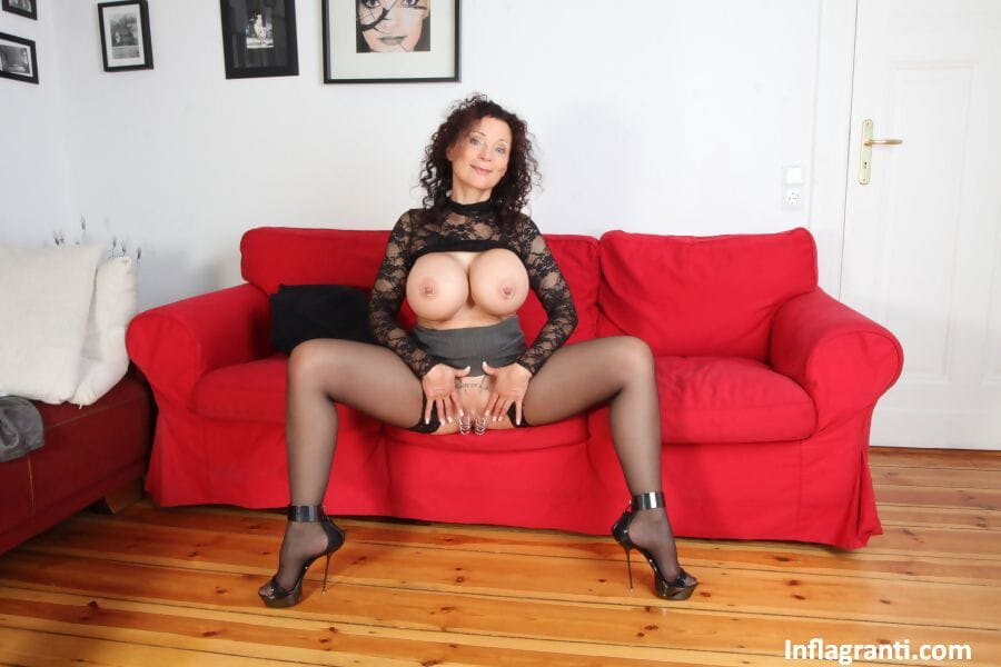 Older first timer Michaella O holds her round boobs during a hardcore fuck