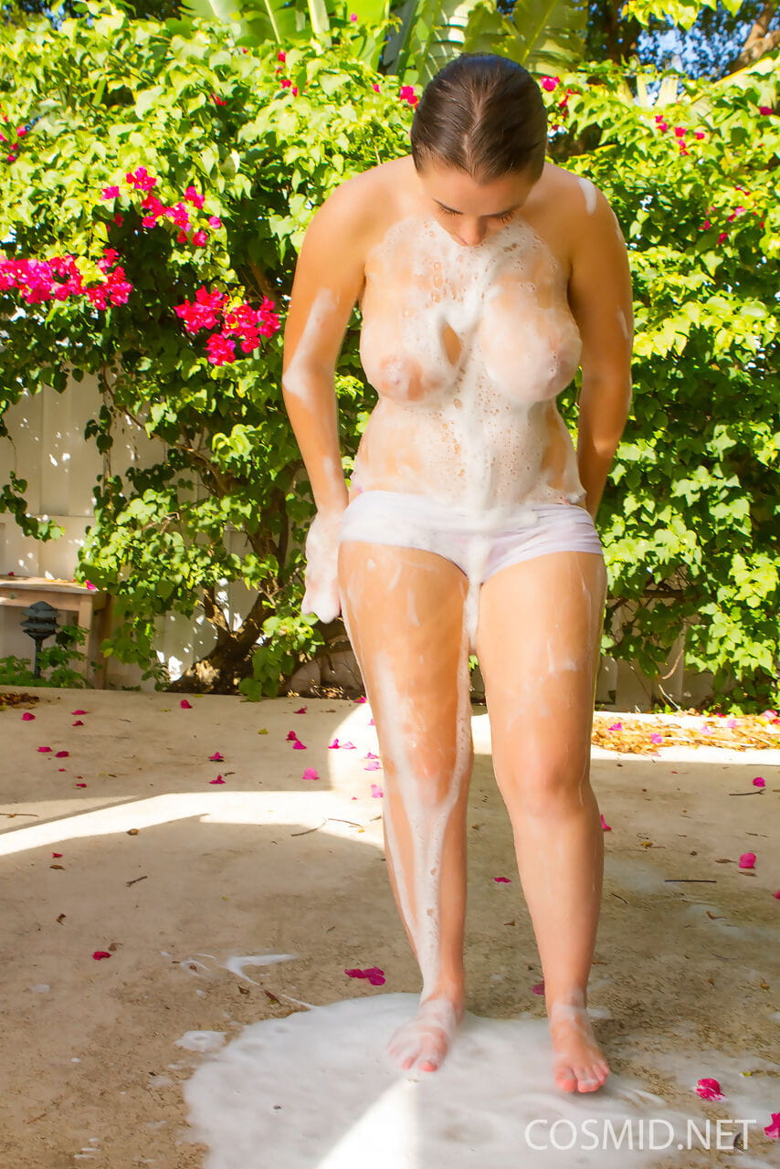 Huge titted Tiffany gets all wet and naughty while washing car