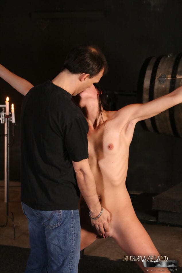 Brunette chick is tied up and subjected to water torture by a cruel man
