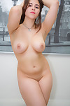 Sexy plump brunette Rachel does a slow striptease to reveal her pudgy ass