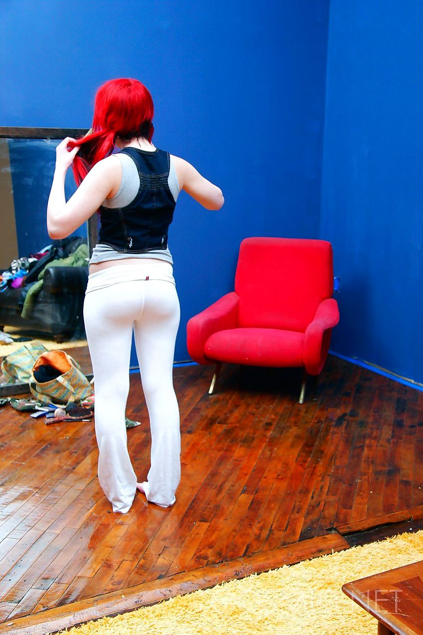 Flaming redhead Tailor unleashes her huge boobs in white leggings