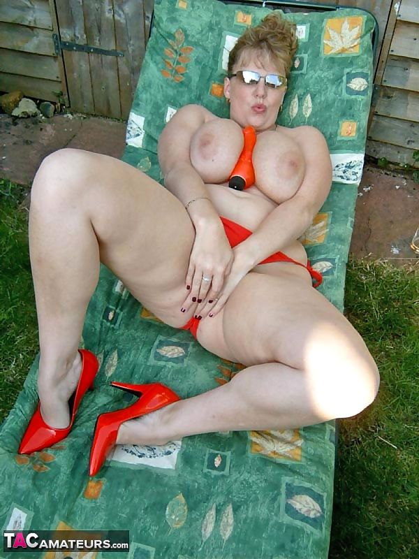 Mature BBW CurvyClaire toys her pussy on lounge chair in backyard