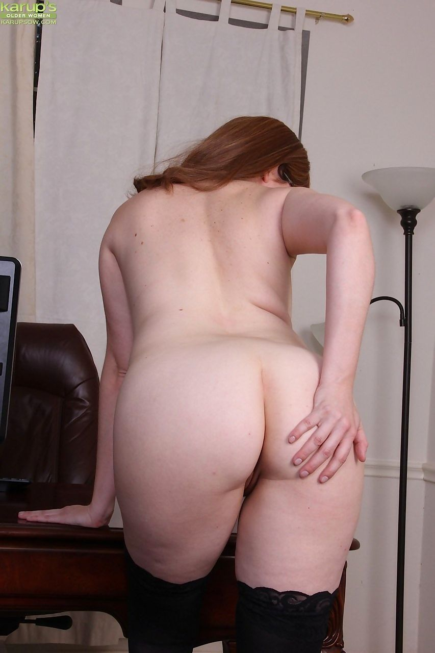 Chubby secretary Bebe Fuller strips to black stockings and glasses after work
