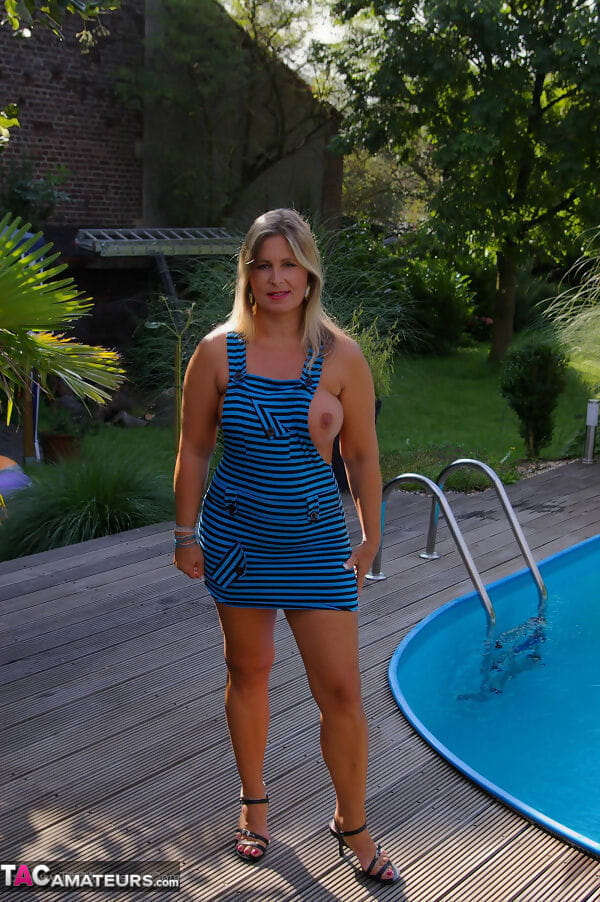 Large plump Chrissy with firm big tits bends to show pierced pussy poolside