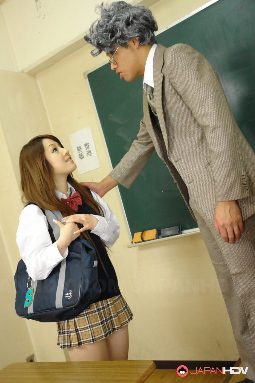 Japanese schoolgirl Ria Sakurai wears cum on face after sex with male teachers