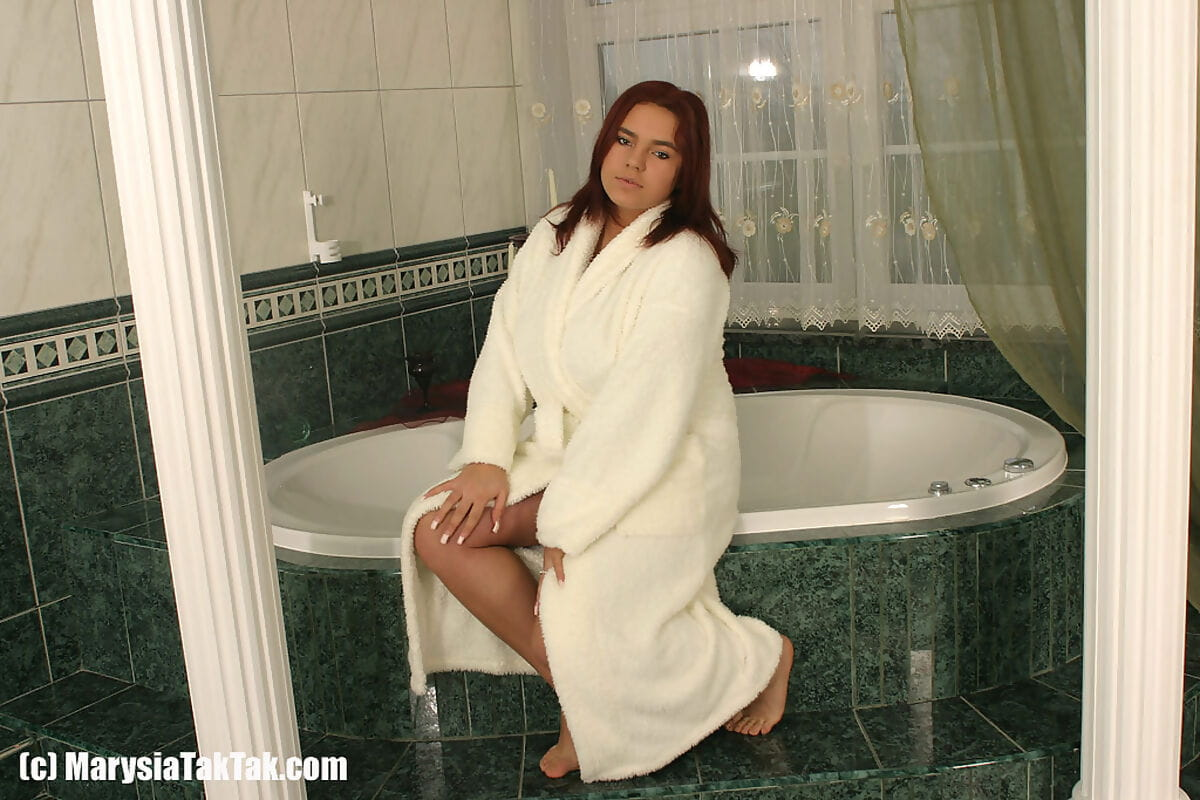 Thick redhead Marysia Taktak sets her giant tits and twat free of her bathrobe