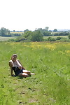 Dirty amateur MILF Denise Davies worships her large melons in the field